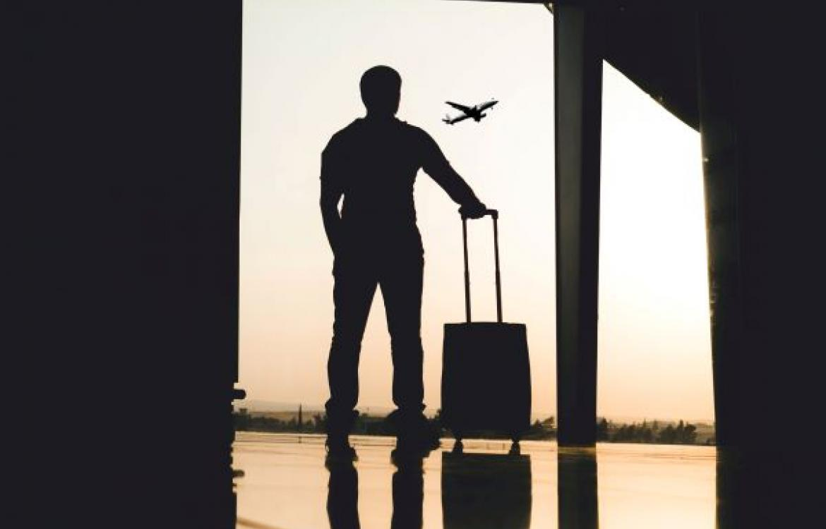 A man's silhouette at an airport